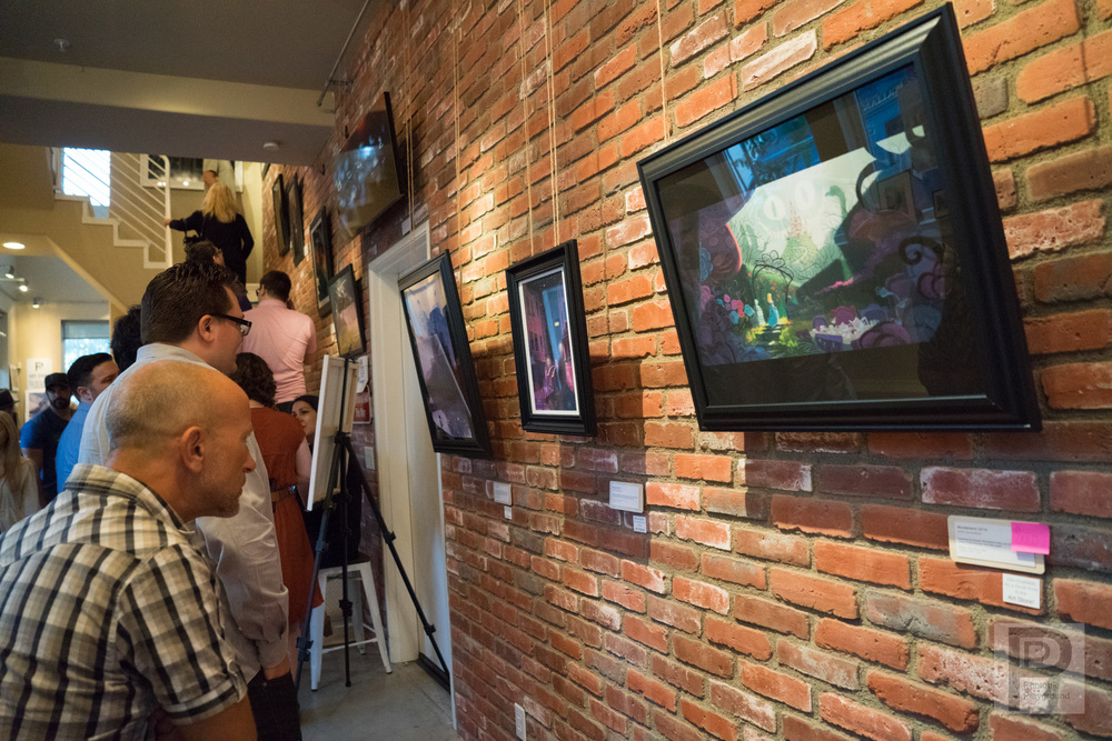 Damarcus Holbrook and Janna Bock exhibit their art for June/July 2015. Pictured here is art by Janna Bock on the brick wall.