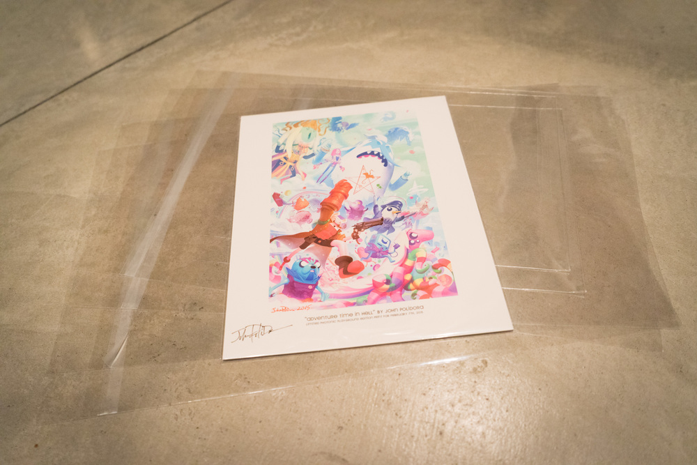 "Plastic sleeves to protect your print against the elements and finger prints. The adhesive is on the sleeve, not on the flap so your print stays clean in and out. This 8.5x11"" print by John Polidora is being protected by a sleeve. This giclée art piece is John Polidora from the February/March 2015 show."