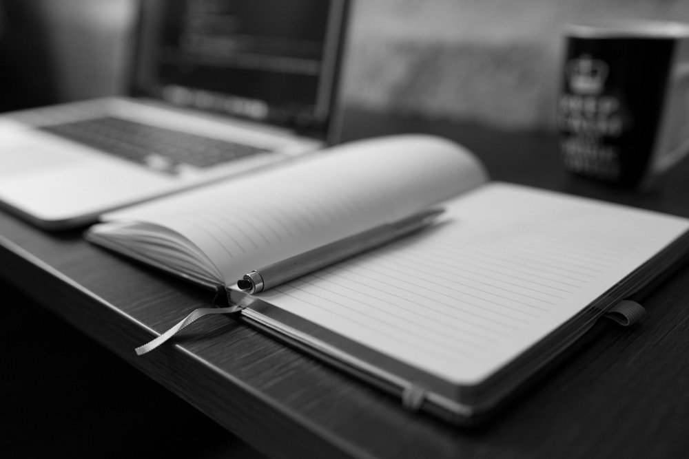notebook-and-ballpoint-with-laptop-in-background (2).jpg