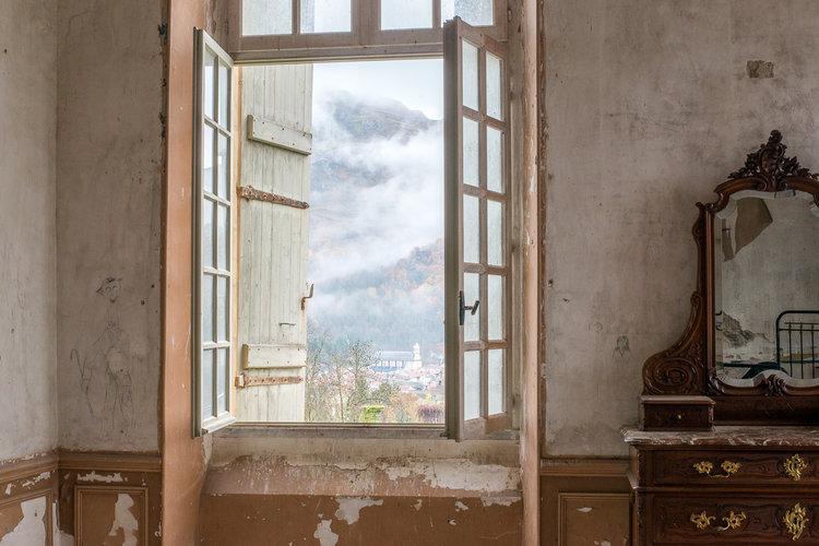 Warm ochre peely paint and centuries of decay look beautiful surrounding these French windows overlooking French countryside. South of France Fixer Upper Château Gudanes. #southoffrance #frenchchateau #provence #frenchcountry #renovation