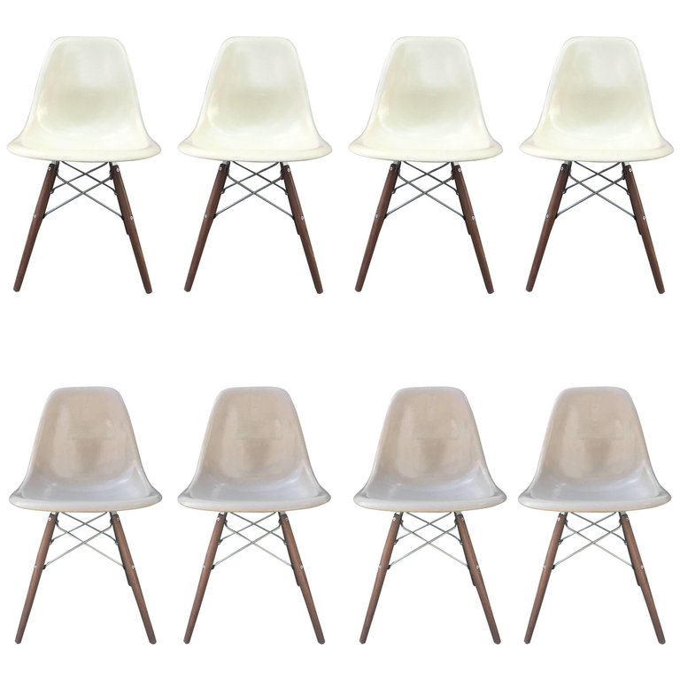 8 orange and ochre eames dining chairs