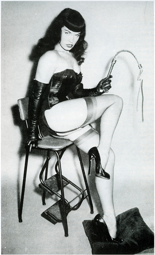 Bettie Page is the original bondage girl complete with riding crop.