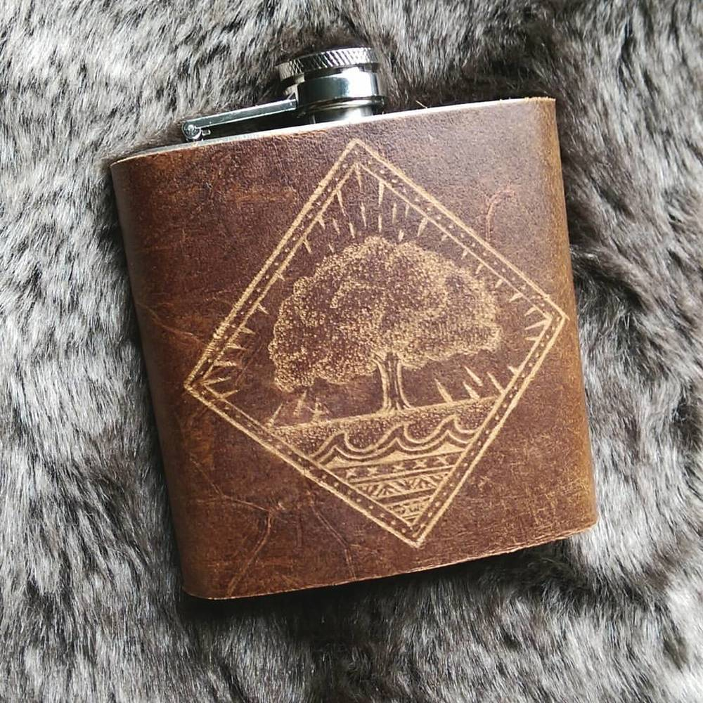Lots of pieces flying out this week! I'm still doing fully customizable flasks. Here is one I've worked on today. It's a slight rework (mostly dimensions) of a tattoo belonging to the soon-to-be flask owner! All done by hand and eye. #landscape #liquor #vsco #vscocam #vscogood #wearevsco #bestofvsco #afterlight #afterlightapp #drinkup #leatherwork #leathercraft #hordstore #leather #shopsmall #handmade #handcrafted #whiskey #whisky #bourbon #scotch #gin #travel #instatravel #illustration #wifetobe #instatraveling #travelgram #liveauthentic #tattoo