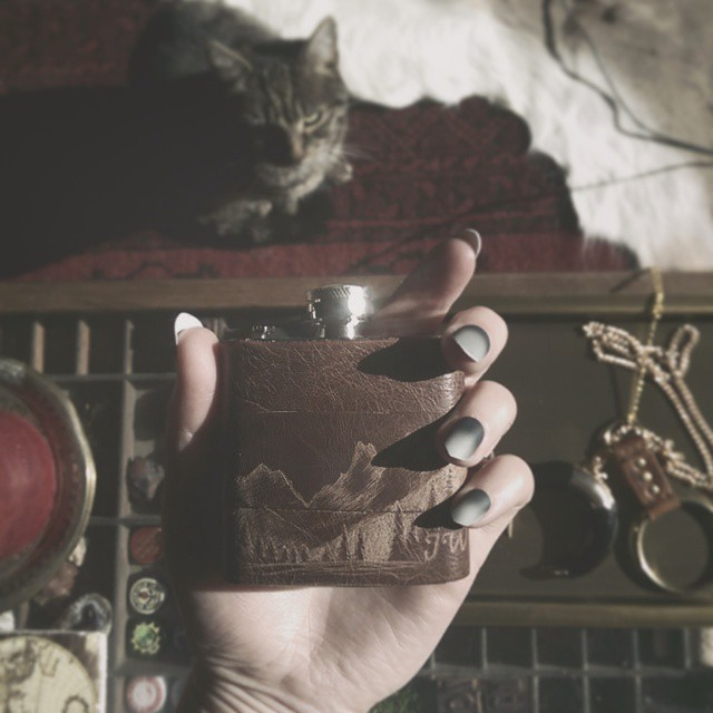 I've been working on a lot of 3oz flasks lately… It's so cute seeing my designs in miniature! Also here is Lils, our tabby furball who likes to invade most of my snaps…. #vsco #vscocam #vscogood #wearevsco #bestofvsco #afterlight #afterlightapp #leatherwork #leathercraft #hordstore #leather #shopsmall #etsy #etsyshop #handmade #handcrafted #tabbycat #miniature #cute