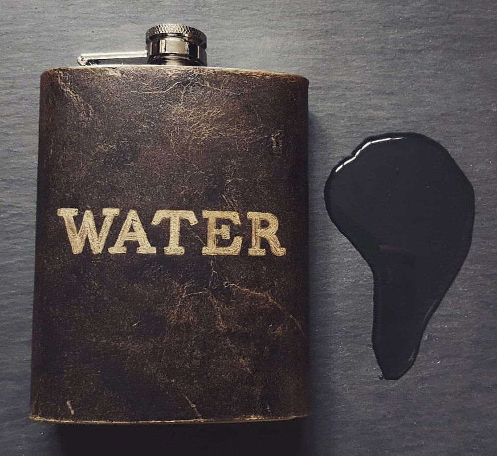 Water engraved hip flask
