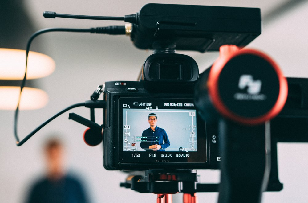 Regularly-scheduled live video amplifies audience engagement. (Photo credit: Samule Sun via Unsplash)