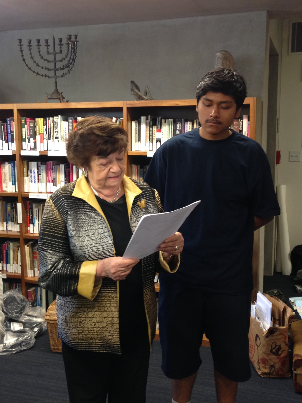 Terezin survivor Ela Weissberger with student participant Manuel Rosas from Harris Newmark High School.