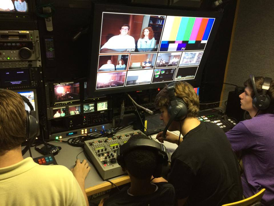 Germantown High School students, from left, Ben Taylor, Derrick Saulsberry, Sean Byrne and Ethan Morton rehearse in the C19 mobile unit forGHS-TV's  Live Coverage of the 2014 Germantown Festival .