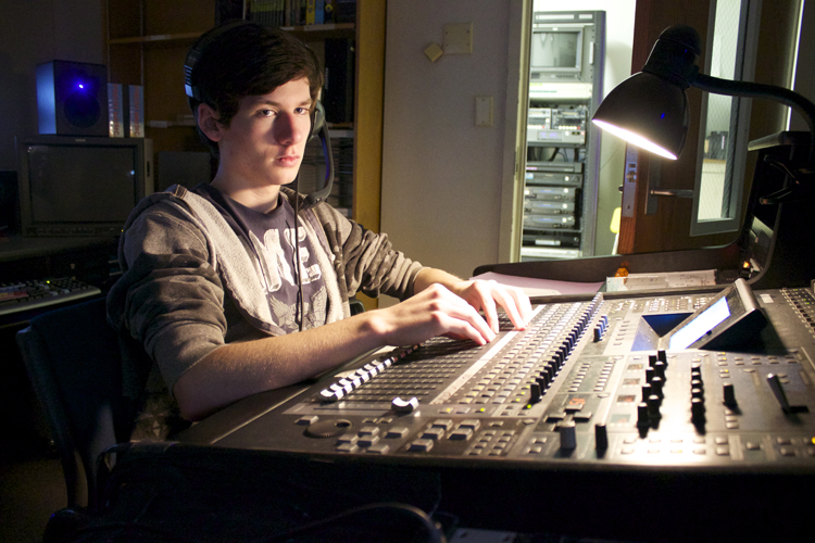 Ethan Morton has to remain focused throughout the live show when operating the audio board. He's responsible for 10 microphones as well as sound levels for the more than one dozen videos played during the production.