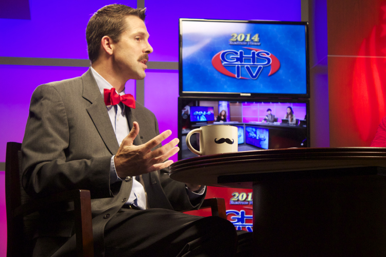 Political analyst and Germantown High teacher Rob Thomas sporting his mustache and mustache mug during the live show.