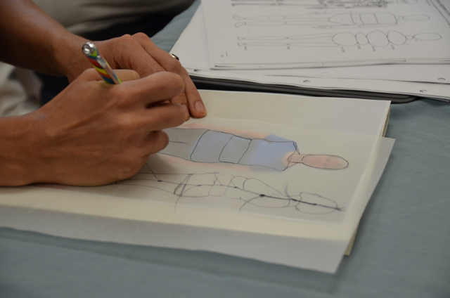 A student traces her body pattern during Aston Kinetics 101 with Mark Barber.