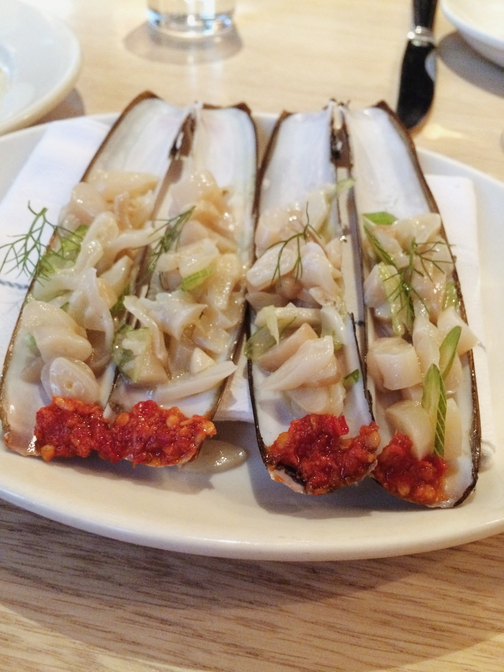The razor clams with pickled chiles and fennel, one of the exquisite crudo dishes Chef Ryan presents.