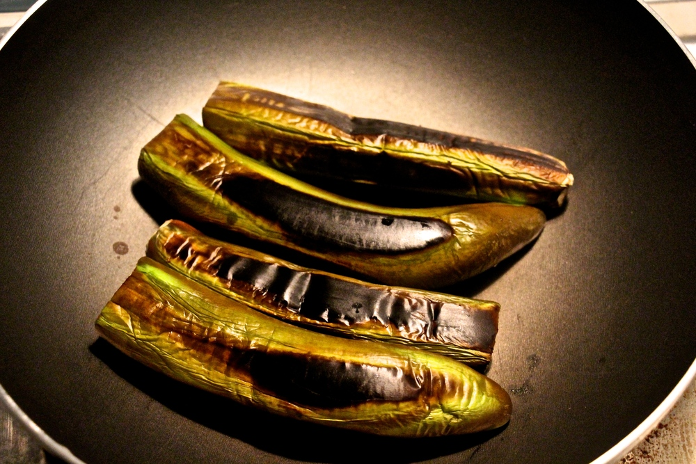 Dry roasting Long Thai Eggplant