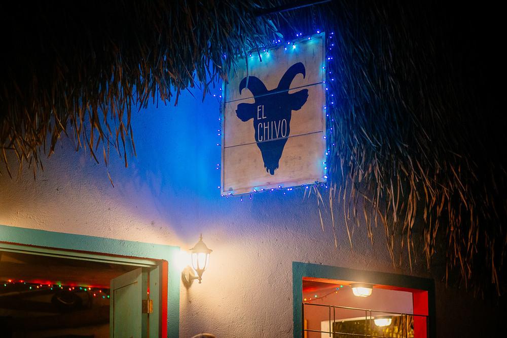 Chivo sign at night