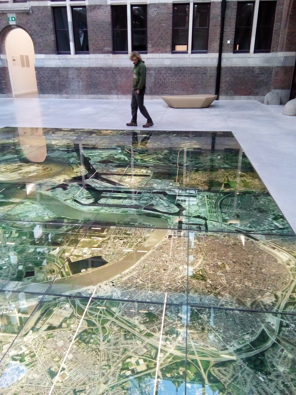 Port House reception area features a photographic map of Antwerp