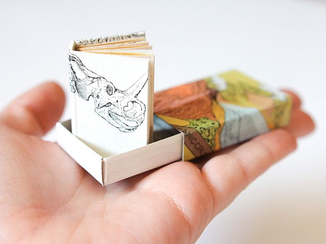 "🌿🦖🌿 ""Dinosaurs eat man, woman inherits the earth."" 🦕 I made this tiny, matchbox sized book a few years ago and found it while cleaning the #kittycatstevensstudio this weekend. 🦕 I still think it's pretty funny to make a #miniaturebook about such big ole creatures. What kind of books should I make next?! Themes? Sizes? I wanna know what you wanna see! 👀📚✨"
