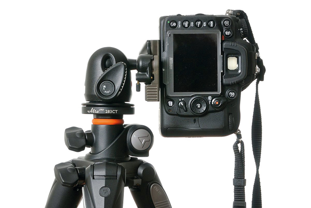 A ball head tripod is ideal for any terrain and let's you switch between horizontal use (landscapes) and vertical use (portraits).