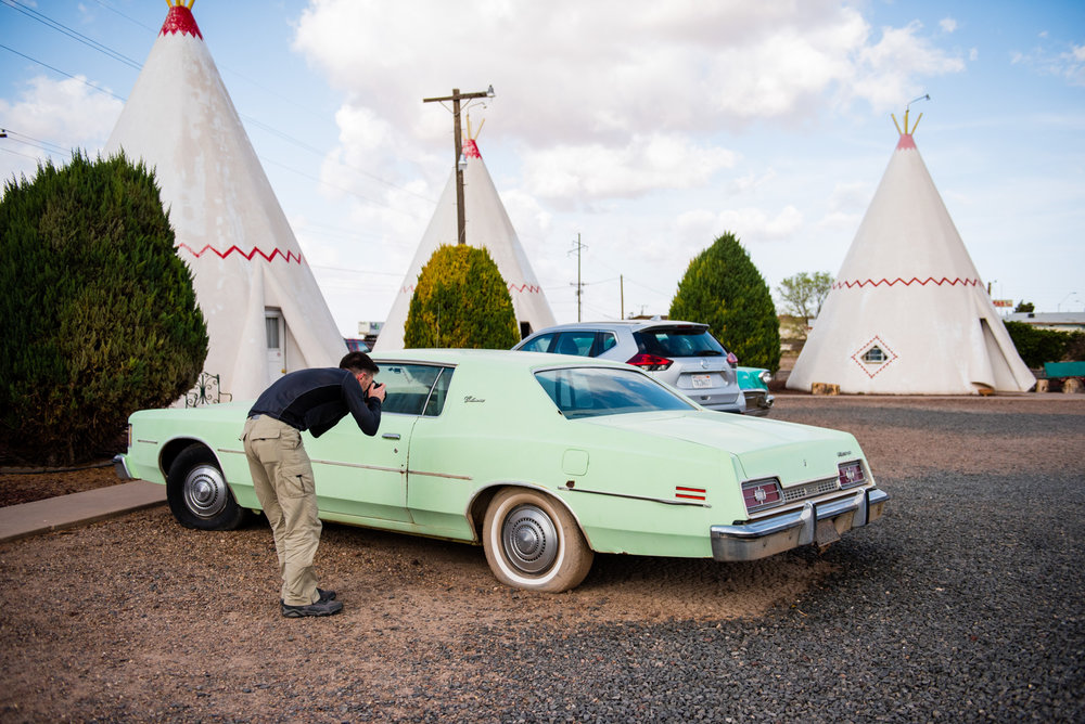 Kris photographing among the wigwams Ⓒ Allie Richards