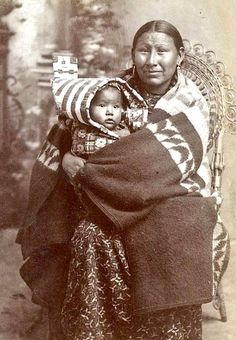 Winyan Tanka (aka Big Woman, aka Mary Big Woman-Under Baggage), the wife of Wapin Ohlate (aka Under Baggage) with her daughter. Oglala Lakota. c. 1895.