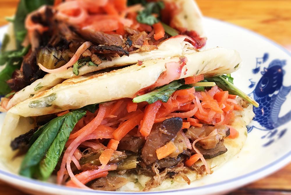 THE PORKO ROSSO - pulled pork, shiitake mushrooms, cranberry hoisin, pickled slaw, greens / 12