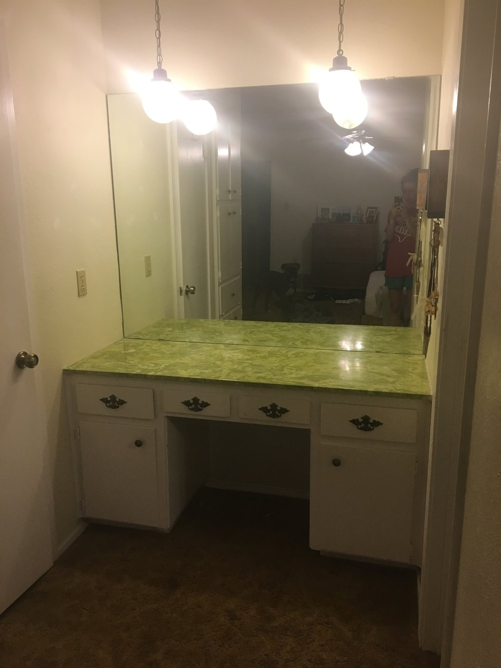look how green it is we opted to use contact paper like jess did in her kitchen we figured that since the vanity is not exposed to water and since it is