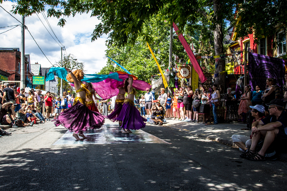 Dancers perform on the street as part of a Kensington Market Pedestrian Sunday event during it's 10th consecutive year.