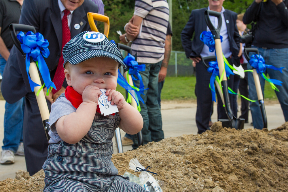 A Future ION rider plays in the sand during the groundbreaking ceremony for Waterloo Region's new Light Rail Transit system.