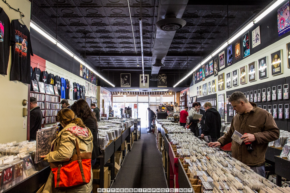 Patrons browse CD's and vinyl albums at Encore Records during Record Store Day.
