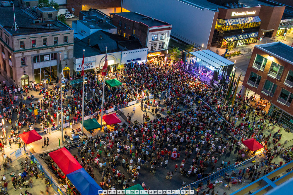 Citizens pack Kitchener's Civic Square to see Sloan perform during Canada Day 2014 celebrations.
