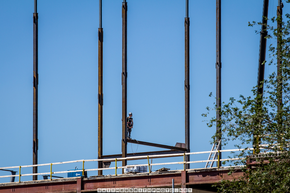 A steel worker waits among the beams as framing commences for Google's new Kitchener office building.