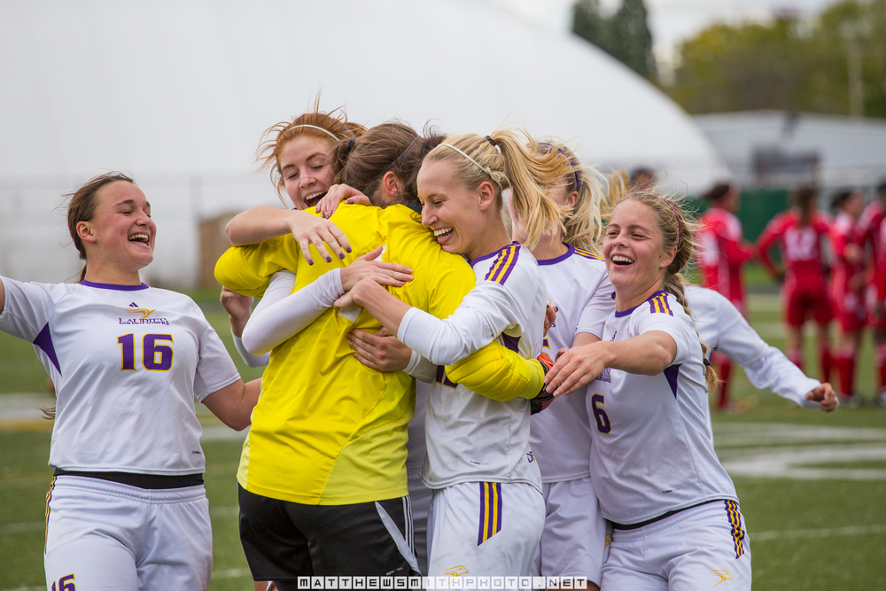 The Laurier Golden Hawks women's soccer team celebrates with their keeper after a dramatic penalty kick victory sends them to the OUA final four.