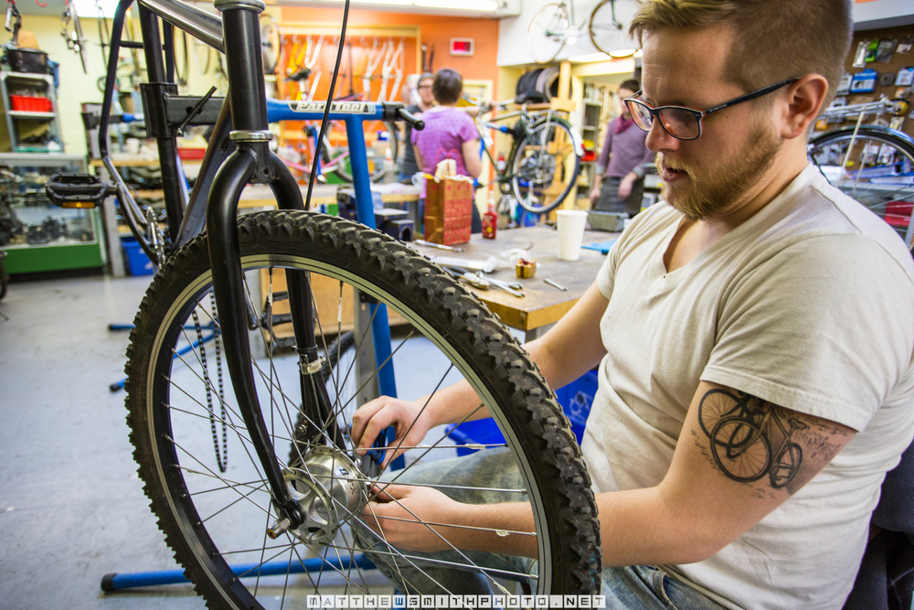 Cyclist, Andrew Morgan prepares his bike for the upcoming winter commuting conditions
