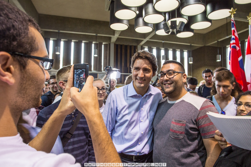 Justin Trudeau poses with a fan after a question and answer session at the University of Waterloo.