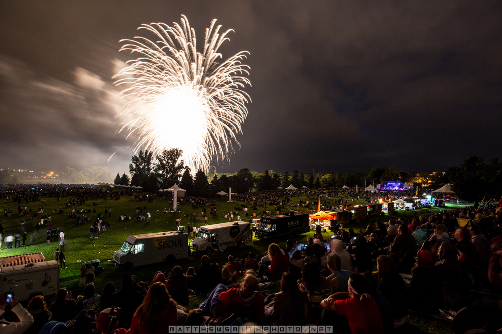 Fireworks explode over a crowd of 65,000 at Canada Day celebrations in Waterloo, Ontario.