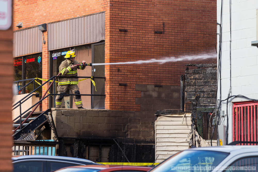 A firefighter douses Marina's bar and restaurant in Downtown Kitchener after a fire destroyed the building leaving the business destroyed and two upstairs tenants displaced