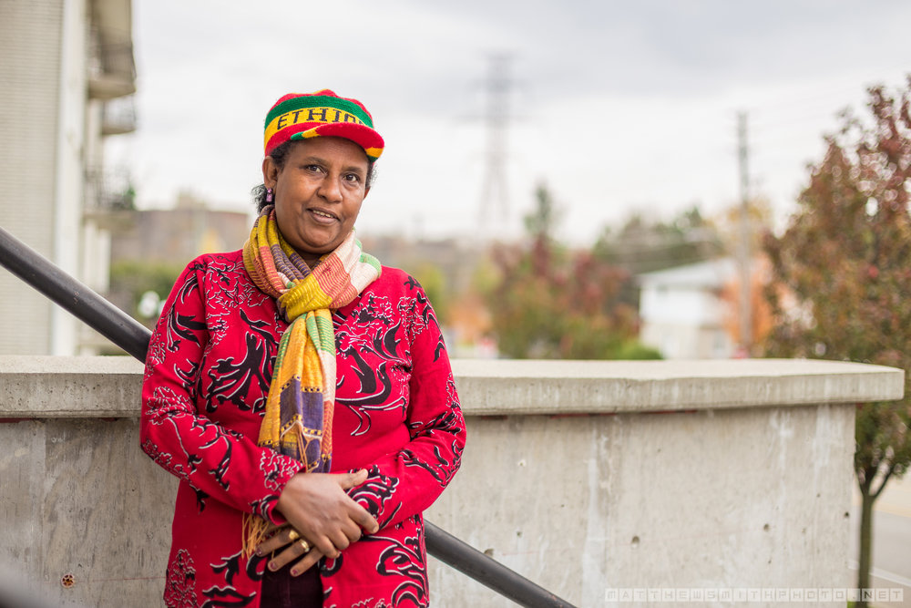 Mamaye Yimegnuhal stands on the front steps of her building after speaking to The Community Edition about her Waterloo neighbourhood, Sunnyvale, and the long process of acclimating to the area after immigrating from Ethiopia.