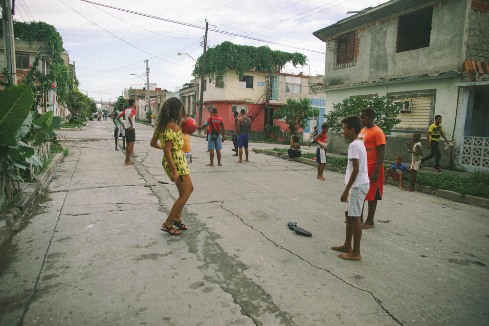 I couldn't help but join in with the children playing football in a neighbourhood street.