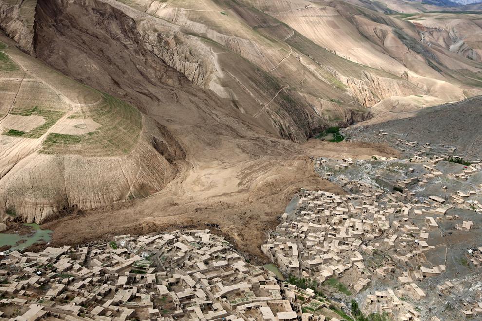 Image (c) Rahmat Gul/AP. Aerial view of landslide.