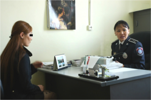 A trafficking victim referred to the authorities by the anti-trafficking hotline is interviewed by police. In 2007, there was a ten-fold increase in trafficking cases registered with the police as a result of the hotline.