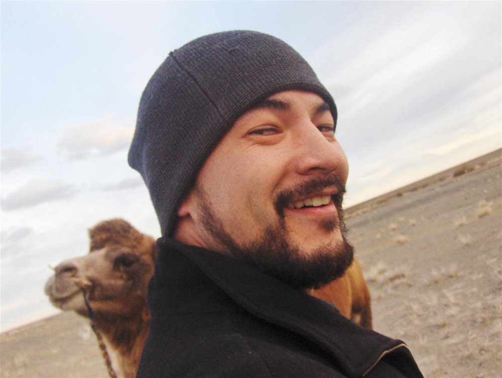 Jason Raby and his camel steed, Mongolia, 2008