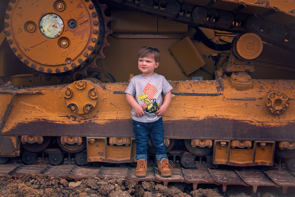 Styled two year old photoshoot with trucks and diggers in cincinnati Ohio