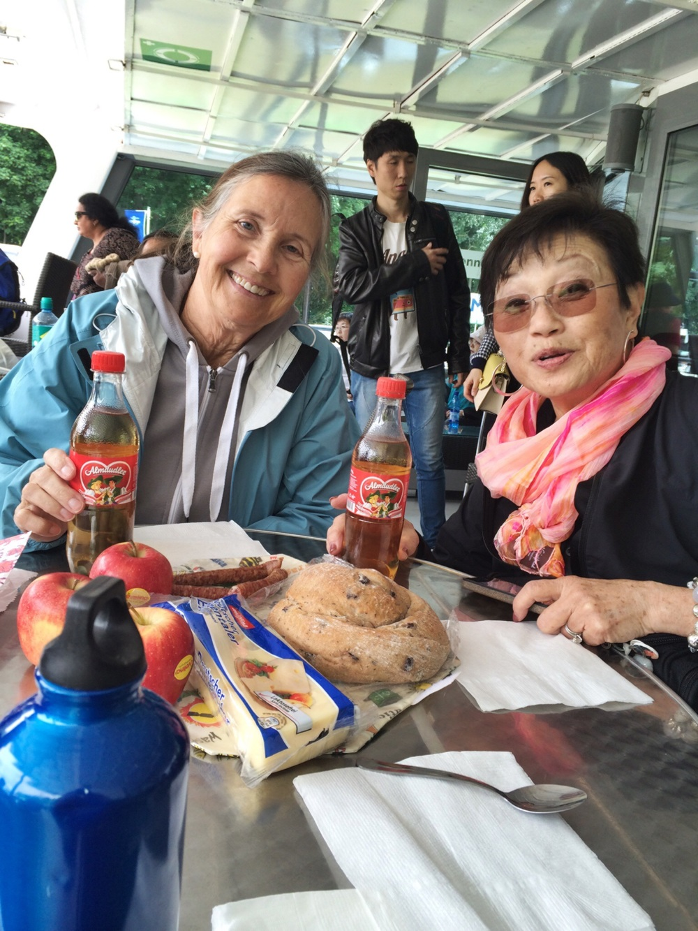 """Picnic lunch on board. Sal and Shirley discover """"Almdudler"""" soda."""