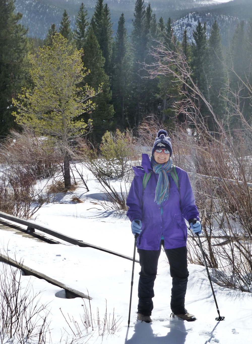 Hiking through the snow at Sprague Lake