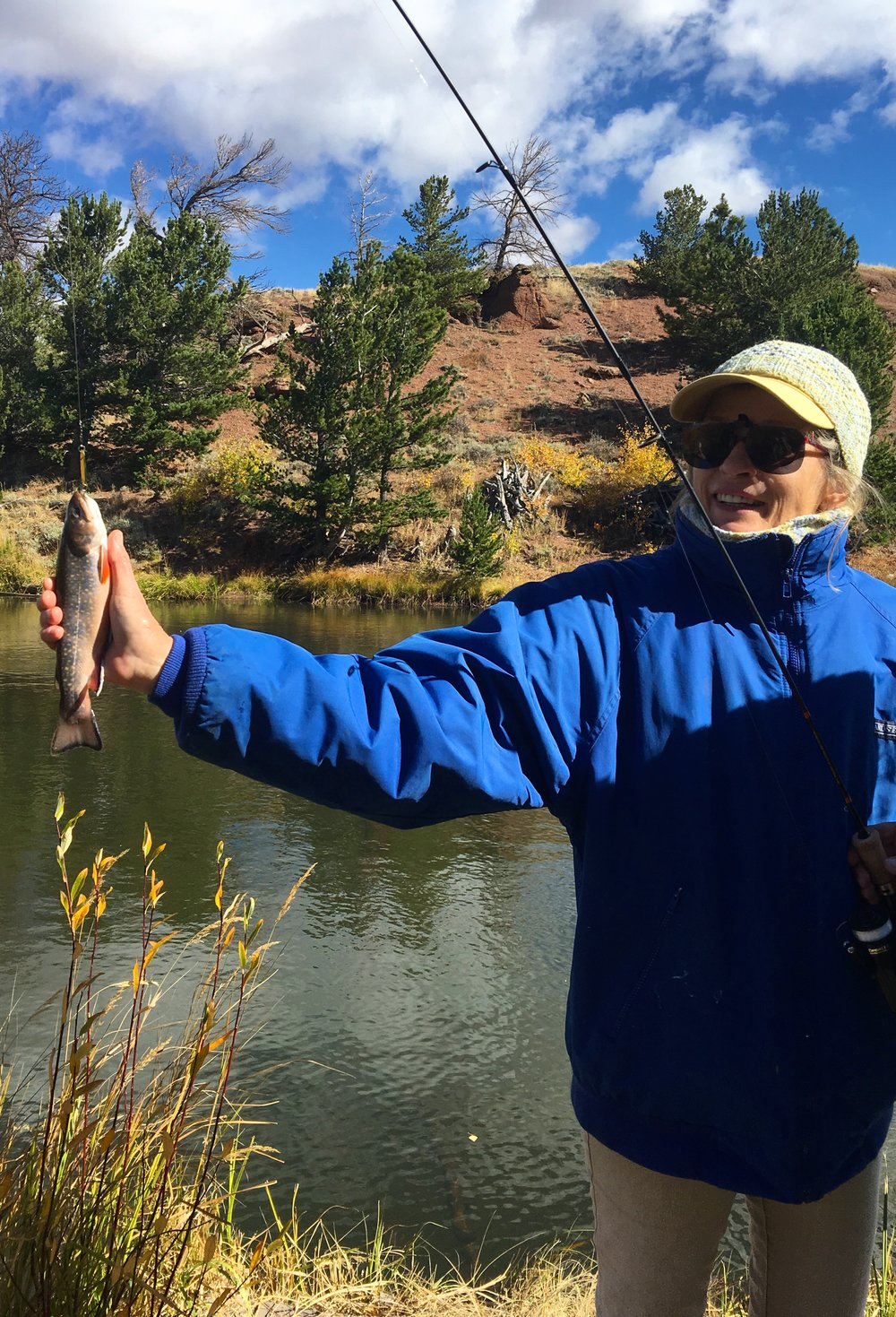 Barbara's first trout!