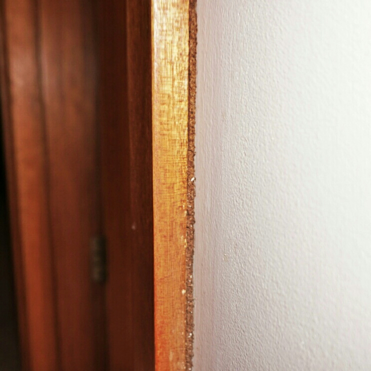 Termite mud packed in behind this architrave is a dead giveaway. Although it may seem really obvious, sometimes the orientation of the door makes it hard to look at the doorway side on.
