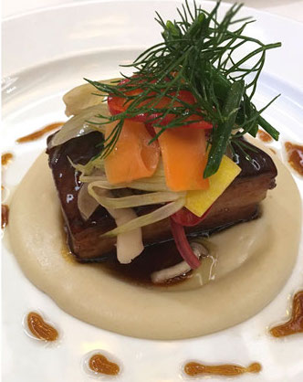 The umami-laden Pork Belly with Umeboshi Glaze and Dashi Poached Turnip Purée (Photo: VeritageMiami)