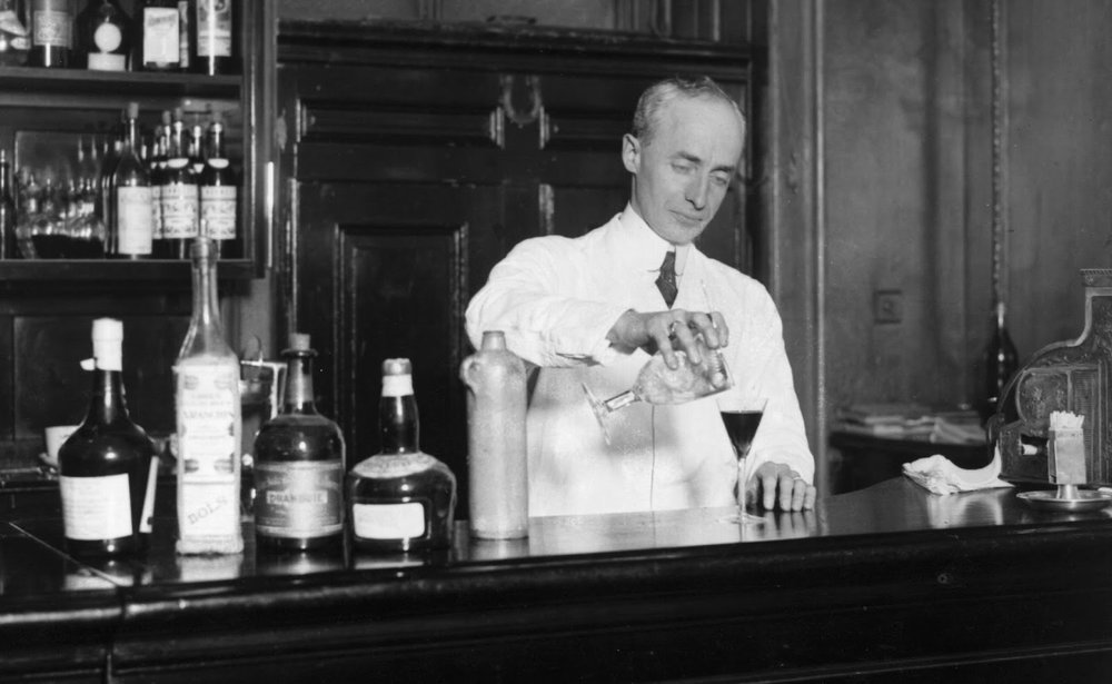 Harry Craddock behind The American Bar at London's Savoy Hotel