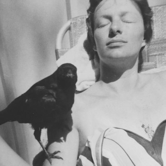 My grandma napping with her pet crow. #casual #womancrushwednesday