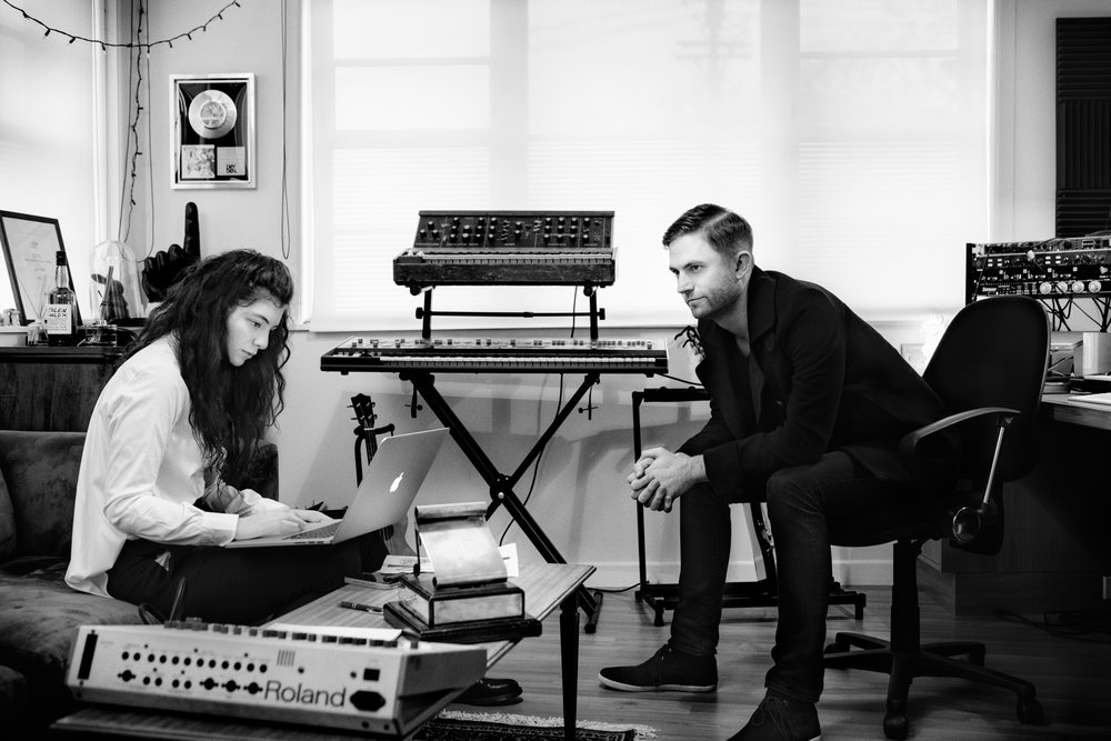 I'm part of a group exhibition at the Auckland Museum - Volume: Making Music in Aotearoa with this image of Lorde and Joel Little in their studio Auckland NZ, a landmark homegrown exhibition on New Zealand music will open at Auckland War Memorial Museum on October 28. A partnership with the New Zealand Music Hall of Fame, Volume is the first major exhibition to tell the story of popular music in Aotearoa. From Pokarekare ana to Poi e, from Loyal to Royals, from dance halls to DJs and from vinyl to mp3s and back again, Volume will take visitors on a musical journey through the decades from the 1950s to today. Music lovers will get to roll up their sleeves and experience how music has been made, heard, and performed over the past 60 years in a 'hands on, ears on' exhibition, exploring the rich diversity and unique sounds that come from our place at the southern edge of the Pacific Ocean. Visitors will be able to step into a recording studio and get behind the mixing desk, become a DJ and blend music and video, browse records in a 1980s record store, learn how to play the opening riff of an iconic Kiwi song, or step back in time and on to the set of C'mon in the 1960s. Drawn from the personal collections of many of our most well-known musicians, Volume will feature costumes, awards, hand-written lyrics, instruments, memorabilia, and hundreds of images that showcase the music that provides the soundtrack to our lives. http://www.aucklandmuseum.com/whats-on/exhibitions/volume-making-music-in-aotearoa