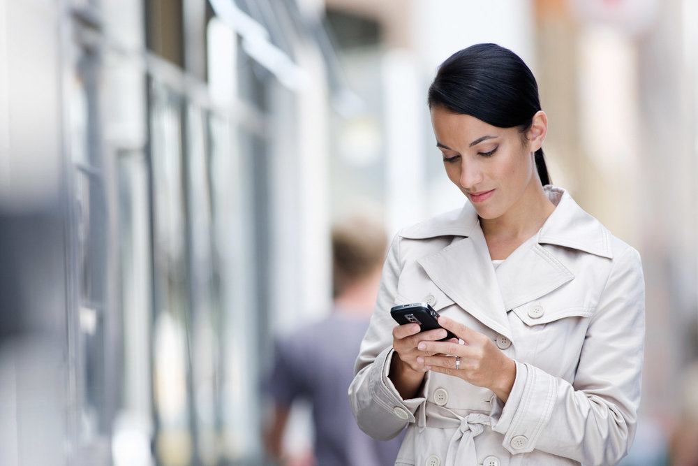 23 Year Old Maori Girl Looking At Her Phone